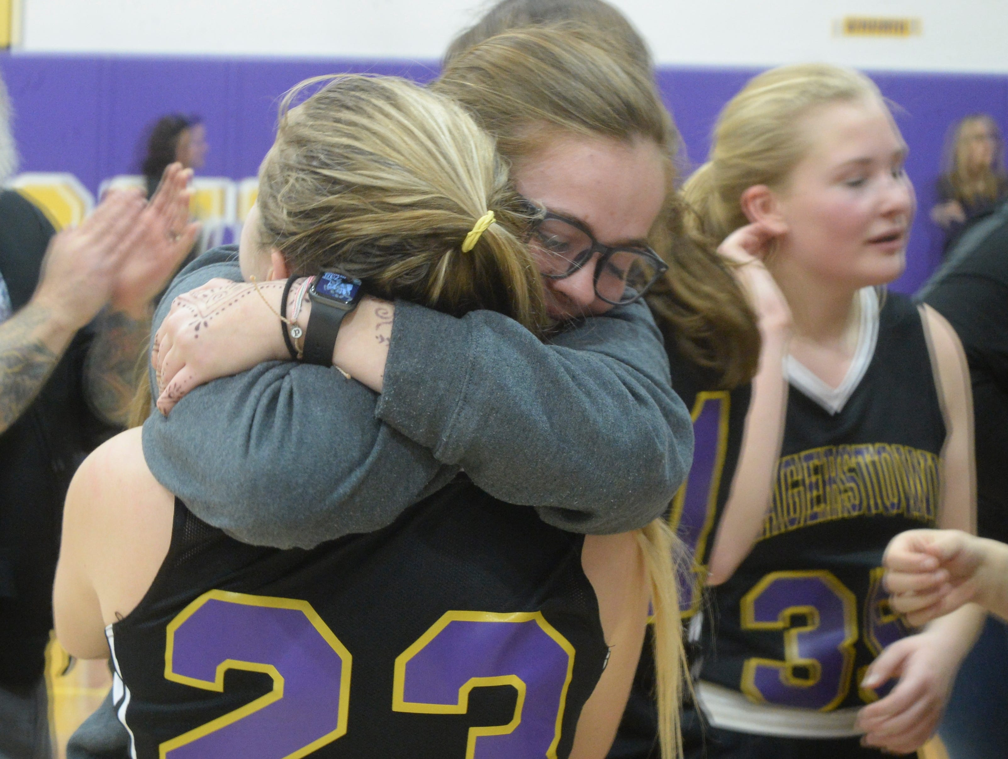 Members of Hagerstown's girls basketball team celebrate during the Wayne County girls basketball championship at Hagerstown Saturday, Jan. 5, 2019. Hagerstown defeated Northeastern 37-35 to win the girls' title, and Northeastern beat Hagerstown 60-49 in the boys championship.