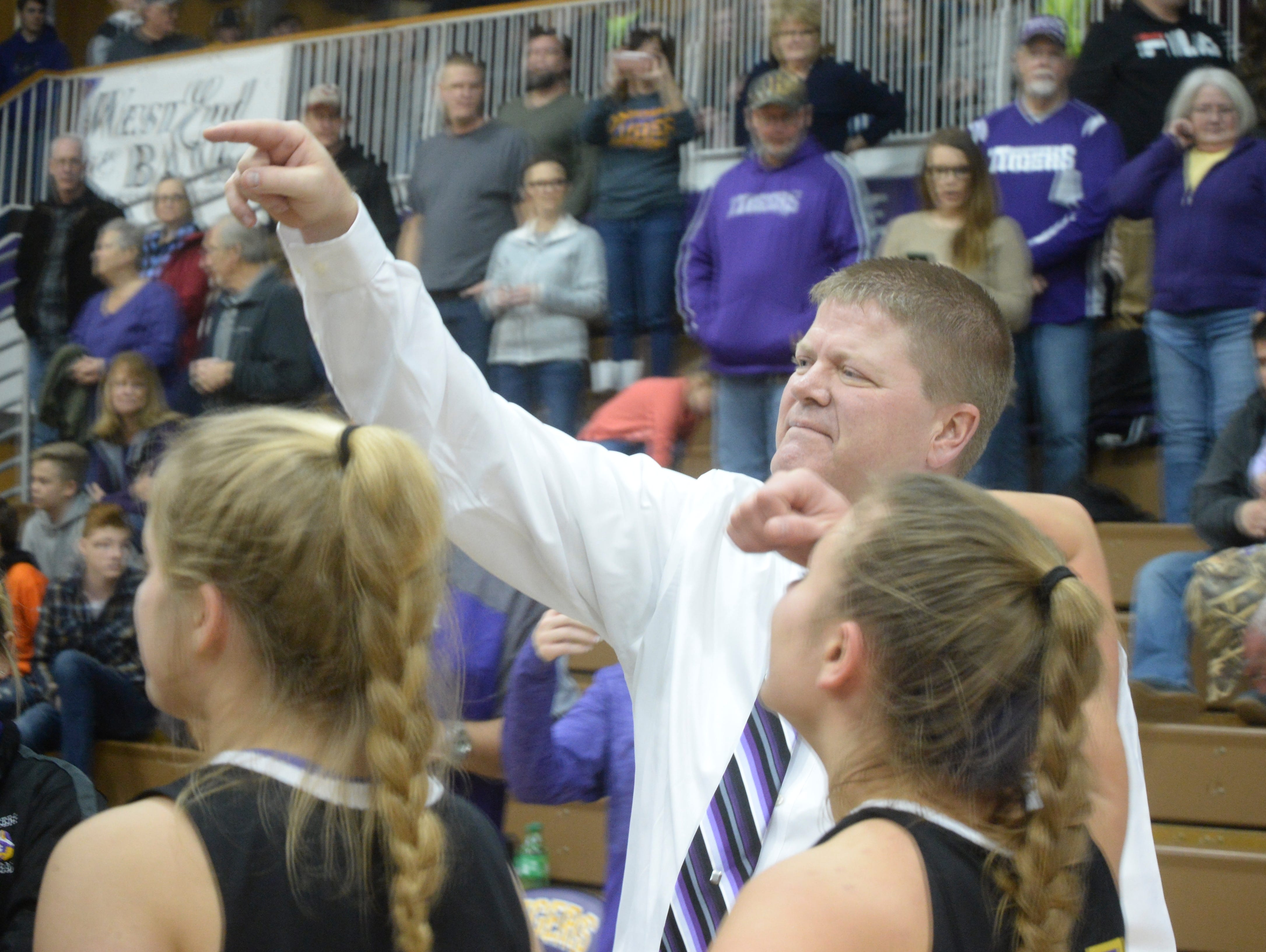 Hagerstown coach Chris Oliger celebrates during the Wayne County girls basketball championship at Hagerstown Saturday, Jan. 5, 2019. Hagerstown defeated Northeastern 37-35 to win the girls' title, and Northeastern beat Hagerstown 60-49 in the boys championship.