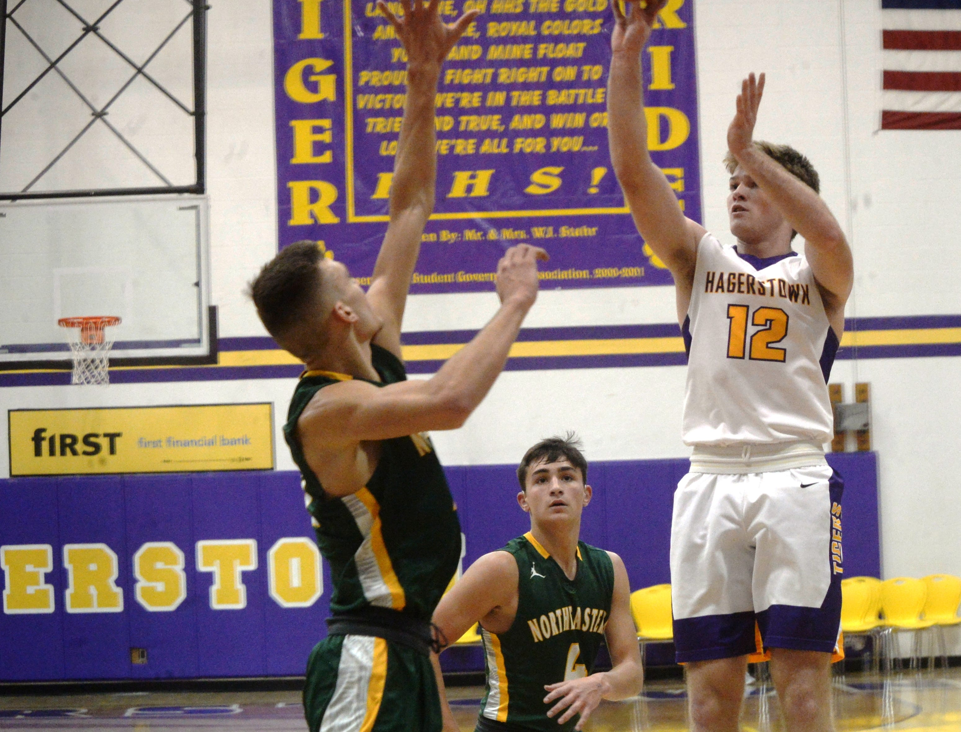 Hagerstown's Cody Swimm shoots the ball during the Wayne County boys basketball championship at Hagerstown Saturday, Jan. 5, 2019. Hagerstown defeated Northeastern 37-35 to win the girls' title, and Northeastern beat Hagerstown 60-49 in the boys championship.