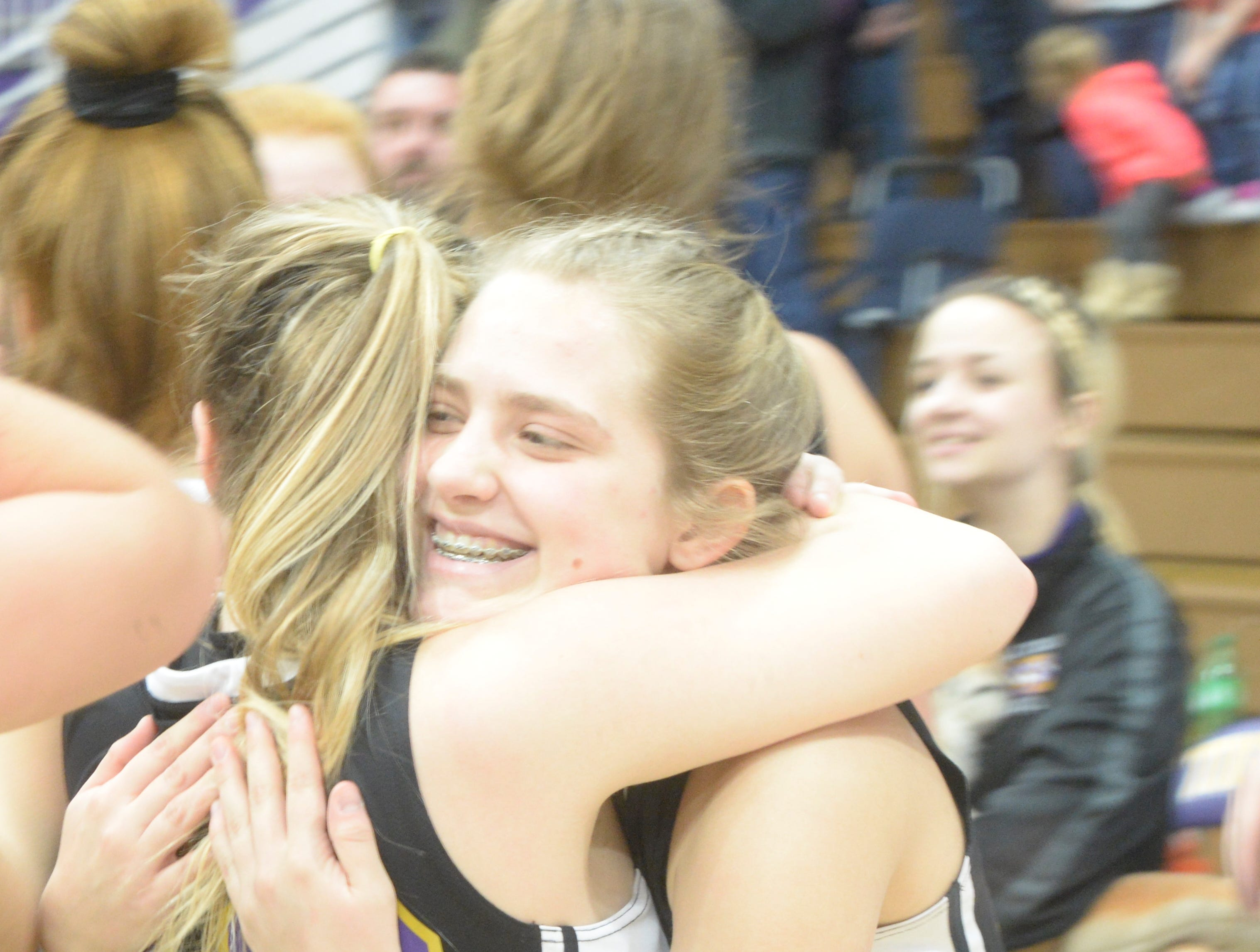 Members of Hagerstown's girls basketball team celebrate following the Wayne County girls basketball championship at Hagerstown Saturday, Jan. 5, 2019. Hagerstown defeated Northeastern 37-35 to win the girls' title, and Northeastern beat Hagerstown 60-49 in the boys championship.