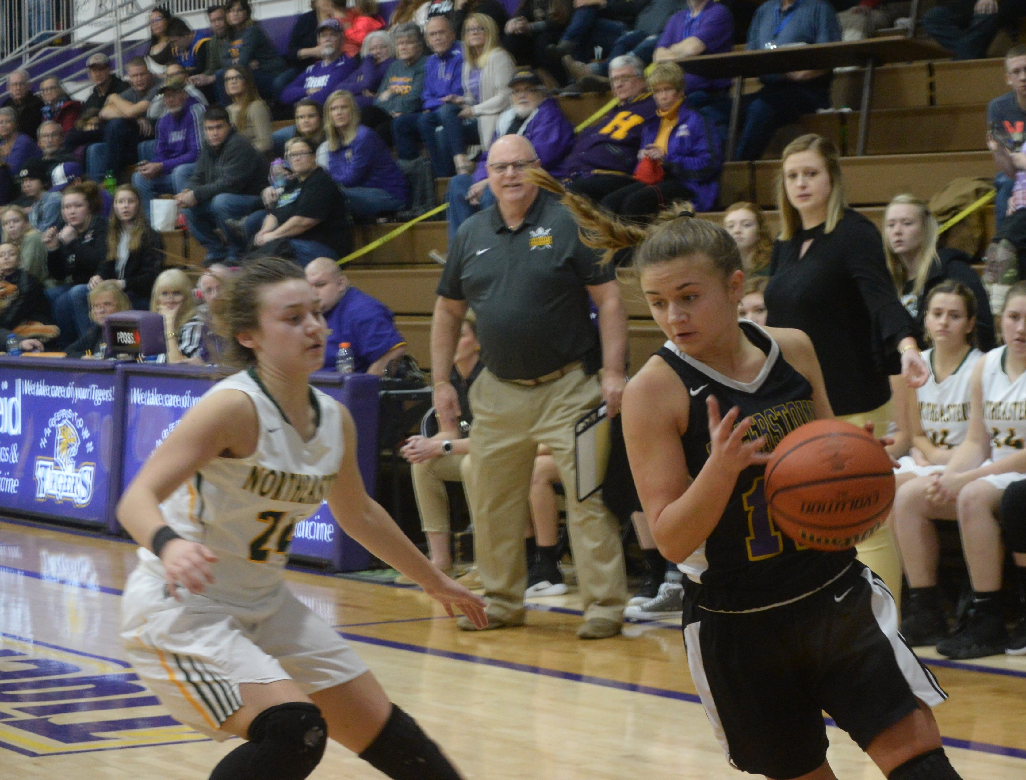 Hagerstown's Camryn Bradway (11) moves the ball against Northeastern's Jenna McFarland (24) during the Wayne County girls basketball championship at Hagerstown Saturday, Jan. 5, 2019. Hagerstown defeated Northeastern 37-35 to win the girls' title, and Northeastern beat Hagerstown 60-49 in the boys championship.