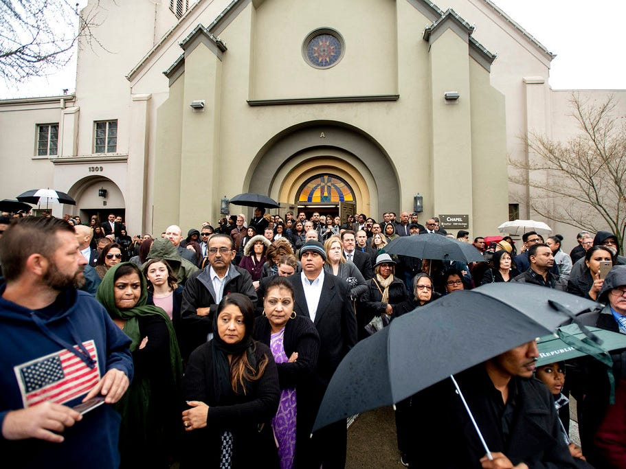 "Mourners gather for the funeral of slain Newman police Cpl. Ronil ""Ron"" Singh on Saturday, Jan. 5, 2019, in Modesto, Calif. According to authorities, prosecutors have charged Gustavo Perez Arriaga, who was in the United States illegally, with Singh's killing."