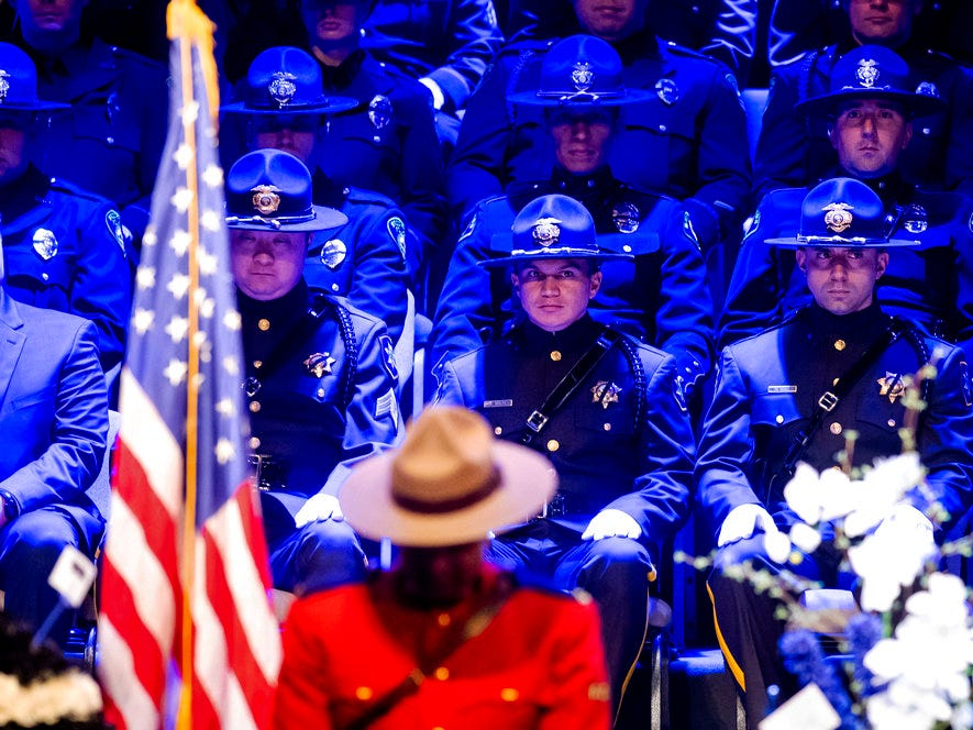 "Police officers gather for the funeral of slain Newman police Cpl. Ronil ""Ron"" Singh on Saturday, Jan. 5, 2019, in Modesto, Calif. According to authorities, prosecutors have charged Gustavo Perez Arriaga, who was in the United States illegally, with Singh's killing."