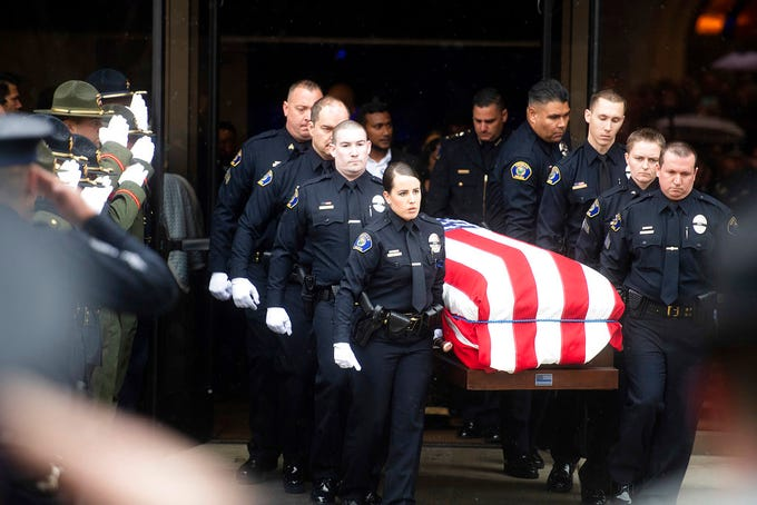 "Newman police officers carry the body of their slain colleague Cpl. Ronil ""Ron"" Singh during his funeral on Saturday, Jan. 5, 2019, in Modesto, Calif. According to authorities, prosecutors have charged Gustavo Perez Arriaga, who was in the United States illegally, with Singh's killing."