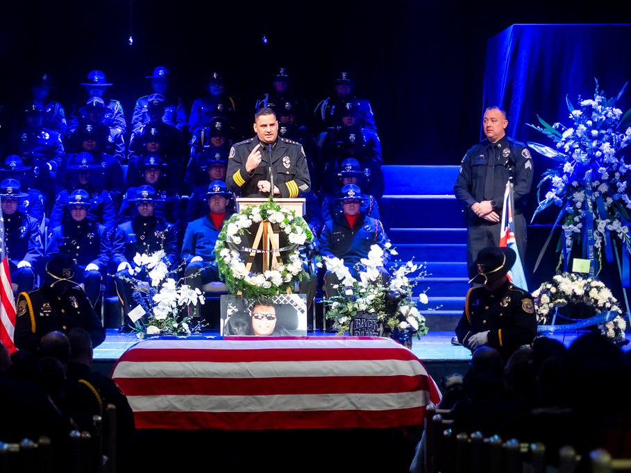 "Newman Police Chief Randy Richardson eulogizes slain officer Cpl. Ronil ""Ron"" Singh at his funeral on Saturday, Jan. 5, 2019, in Modesto, Calif. According to authorities, prosecutors have charged Gustavo Perez Arriaga, who was in the United States illegally, with Singh's killing."