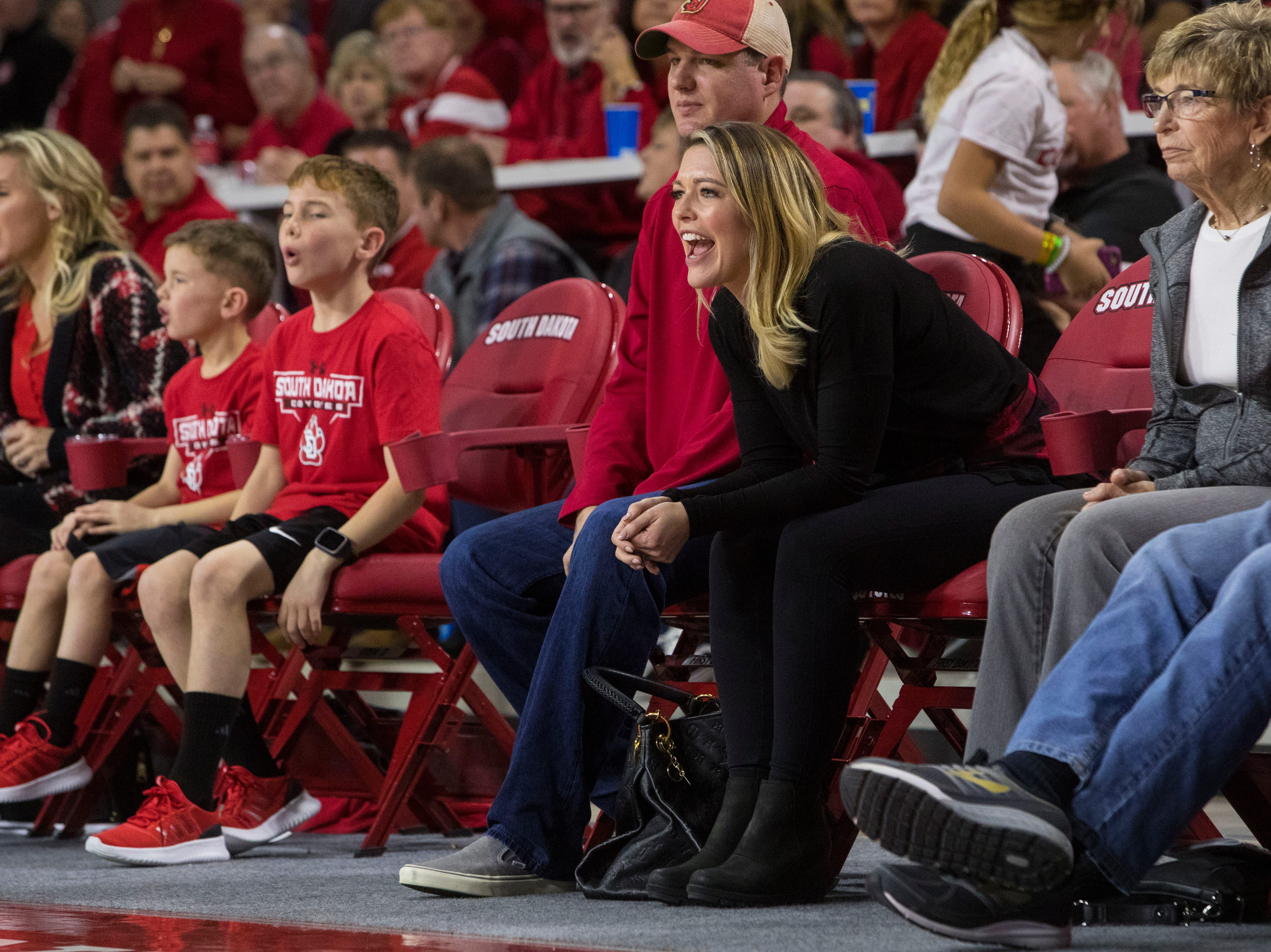 Audience members cheer for their team during the SDSU and USD game, Sunday, Jan. 6, 2019 in Vermillion, S.D.