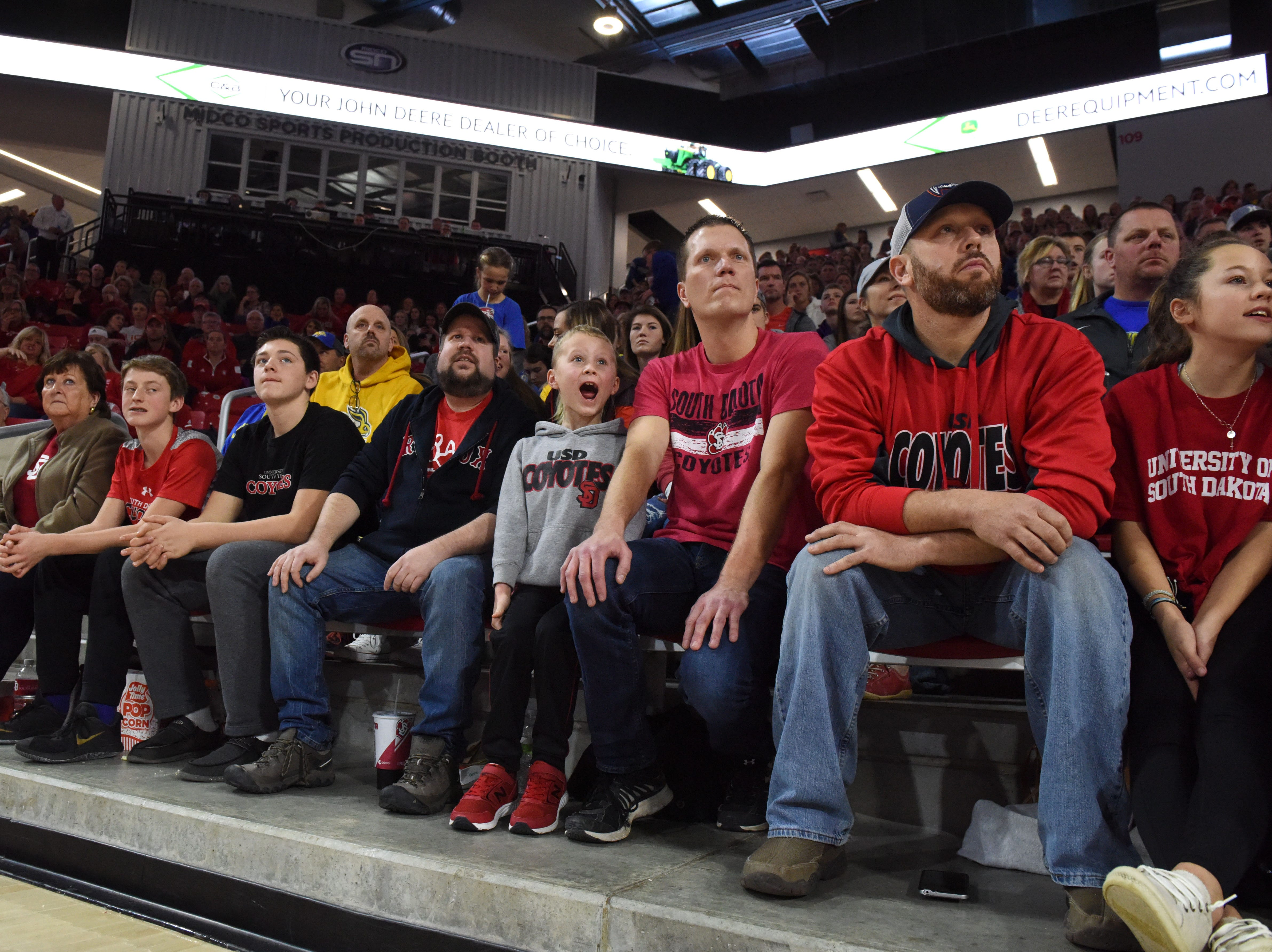 Audience members react during the SDSU and USD game, Sunday, Jan. 6, 2019 in Vermillion, S.D.