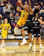Vishe` Rabb of Augustana attempts a shot over the defense by Jasmine Harris of USF during Saturday's game in Sioux Falls.