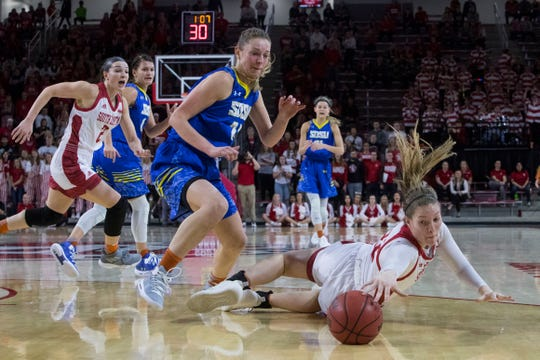SDSU's Tagyn Larson (24) and USD's Chloe Lamb (22) go for the ball during a game, Sunday, Jan. 6, 2019 in Vermillion, S.D.