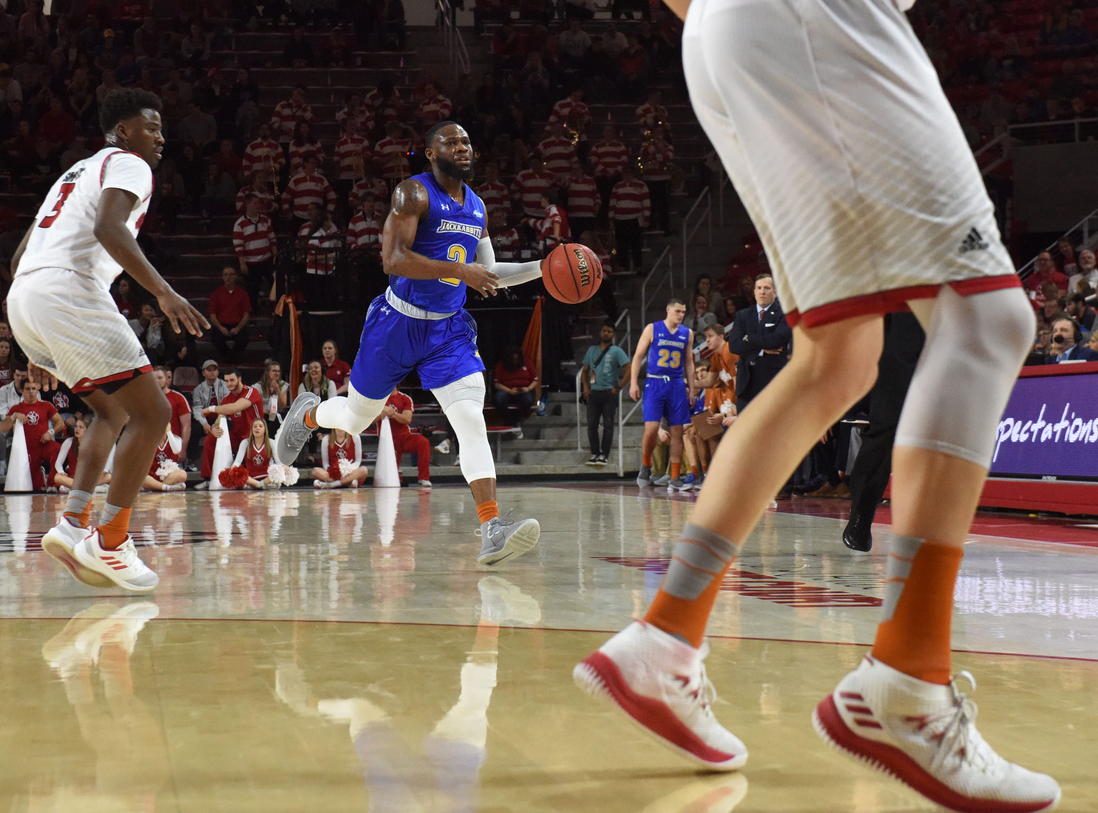 SDSU's Tevin King (2) dribbles the ball past USD players during a game, Sunday, Jan. 6, 2019 in Vermillion, S.D.