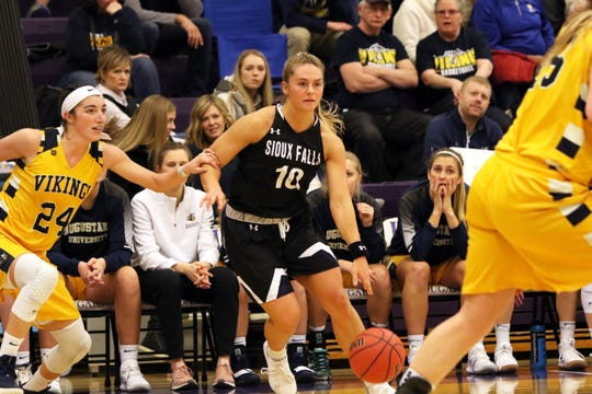 Jessie Geer of USF turns the corner as Janelle Shiffler of Augustana defends during Saturday's game at USF.