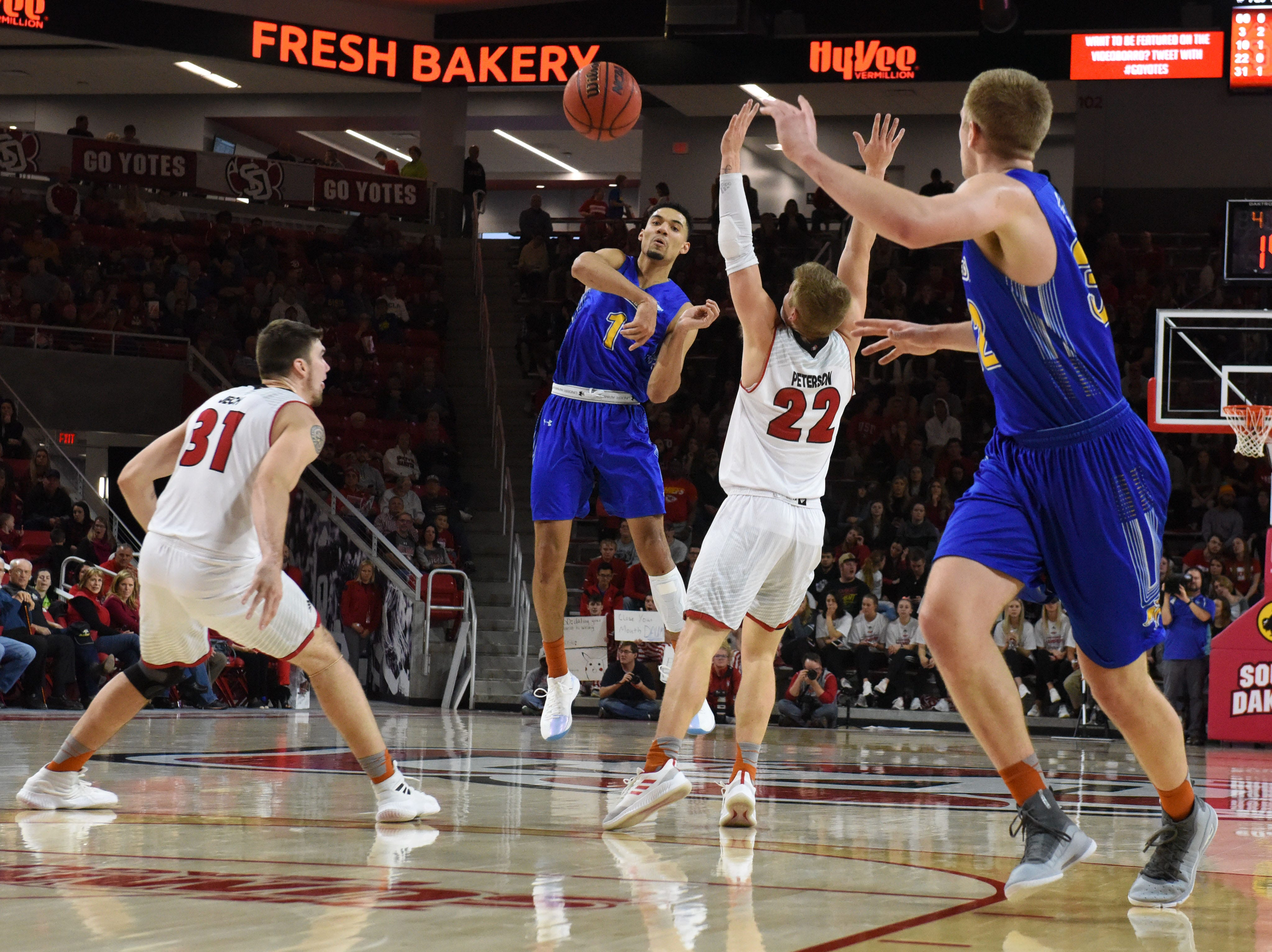 SDSU's Skyler Flatten (1) passes the ball during a game against USD, Sunday, Jan. 6, 2019 in Vermillion, S.D.