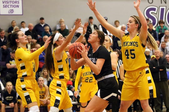 Anna Goodhope of USF attempts a shot between several Augustana players during Saturday's game at USF.