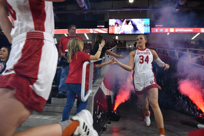 USD's Hannah Sjerven (34) runs onto the court before the SDSU game, Sunday, Jan. 6, 2019 in Vermillion, S.D.