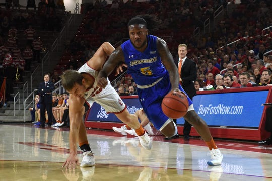 SDSU's David Jenkins (5) dribbles the ball past USD player during a game, Sunday, Jan. 6, 2019 in Vermillion, S.D.