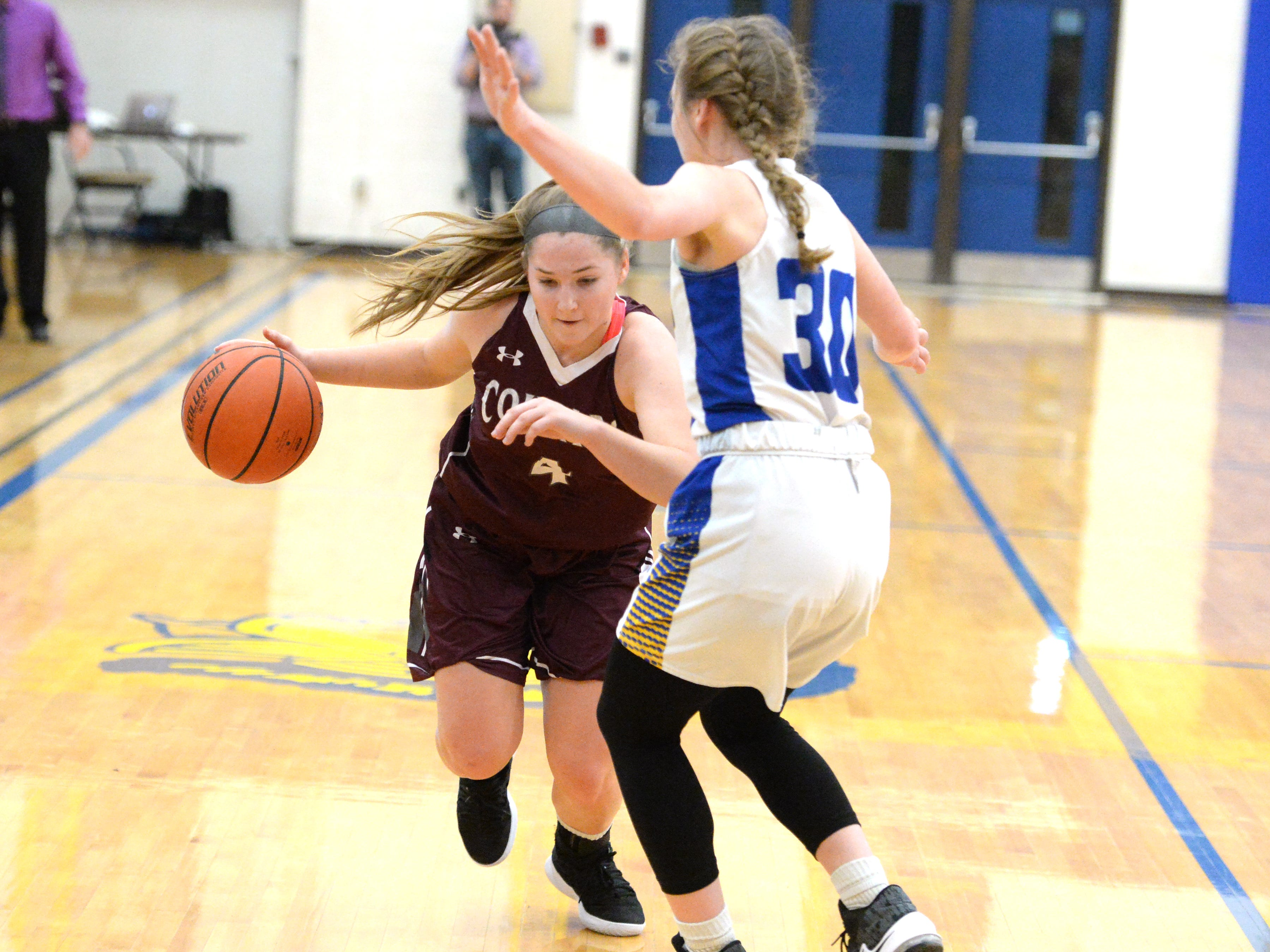 Stuarts Draft's Maggie Sorrels attempts to drive around Western Albemarle's Elisabeth Coffman Saturday at the Play for Preemies Showcase at Western Albemarle High School.