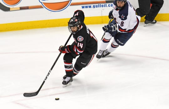 St. Cloud State's Patrick Newell handles the puck Saturday as Robert Morris' Eric Israel (8) defends. Newell scored a goal in SCSU's 5-2 win at Pittsburgh.