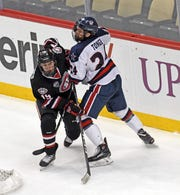 St. Cloud State's Sam Hentges tangles with Robert Morris' Alex Tonge (right) on Saturday in Pittsburgh. SCSU won 5-3.