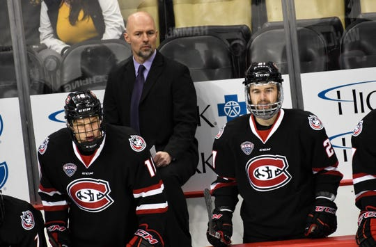 Head coach Brett Larson watches the action from St. Cloud State's bench Saturday in Pittsburgh at the Three Rivers Classic. SCSU beat host Robert Morris, 5-2.