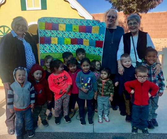 Representatives from the Daughters of Utah Pioneers McQuarrie Memorial Museum presented a donation of handmade quilts to the Root for Kids organization, which serves families through Early Head Start, Early Intervention and Parents as Teachers home visiting programs in Washington County and on the Arizona Strip.