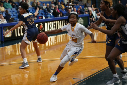 Tallahassee Community College Eagles guard Tameria Johnson (10) drives the ball to the hoop for a layup versus Gulf Coast State College.