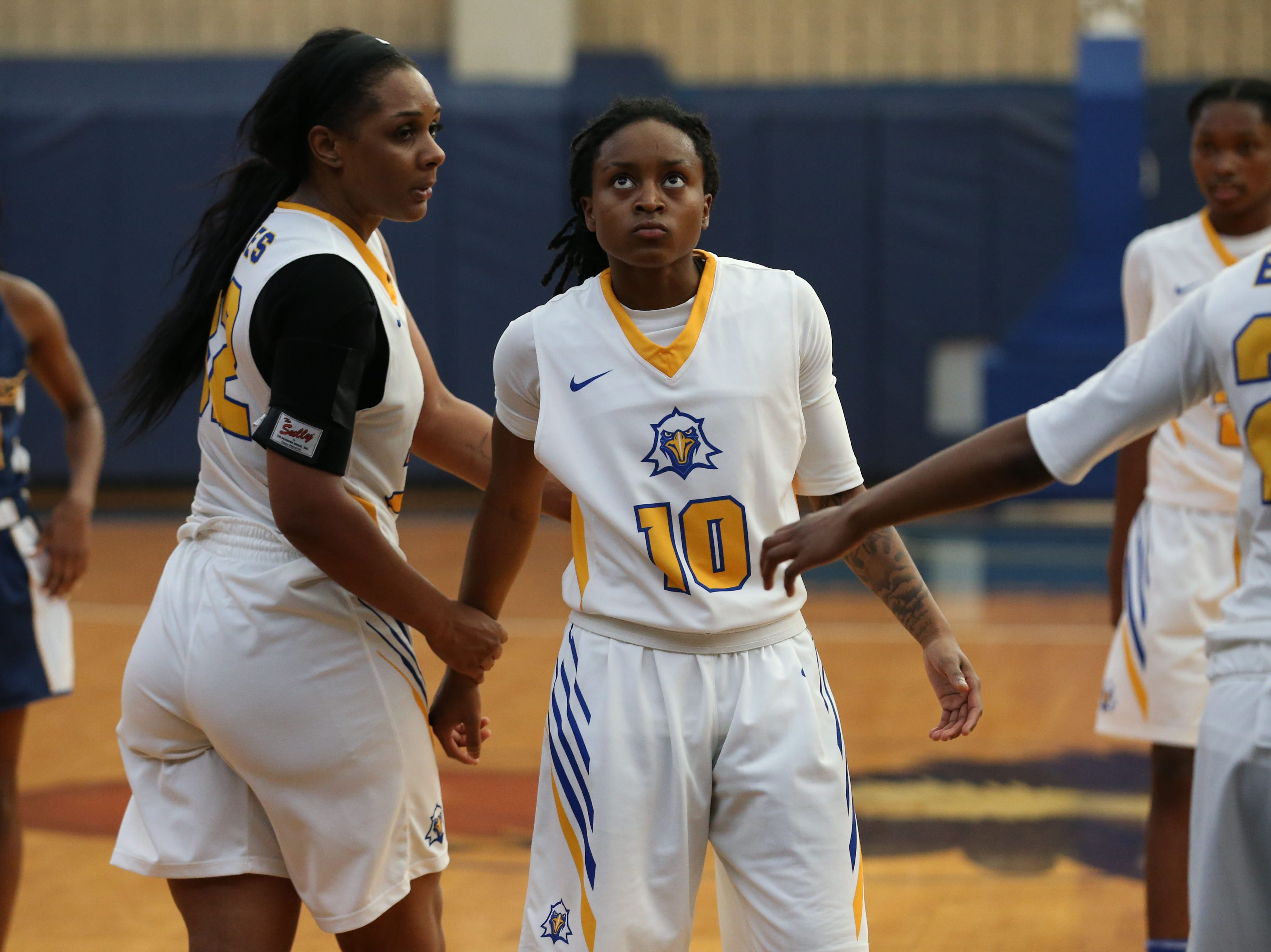 Tallahassee Community College Eagles guard Tameria Johnson (10) receives high-fives and encouragement from teammates after missing a free throw. The Tallahassee Community College Eagles host the Gulf Coast State College Commodores in a conference match-up in the Eagledome, Saturday, Jan. 5, 2019.
