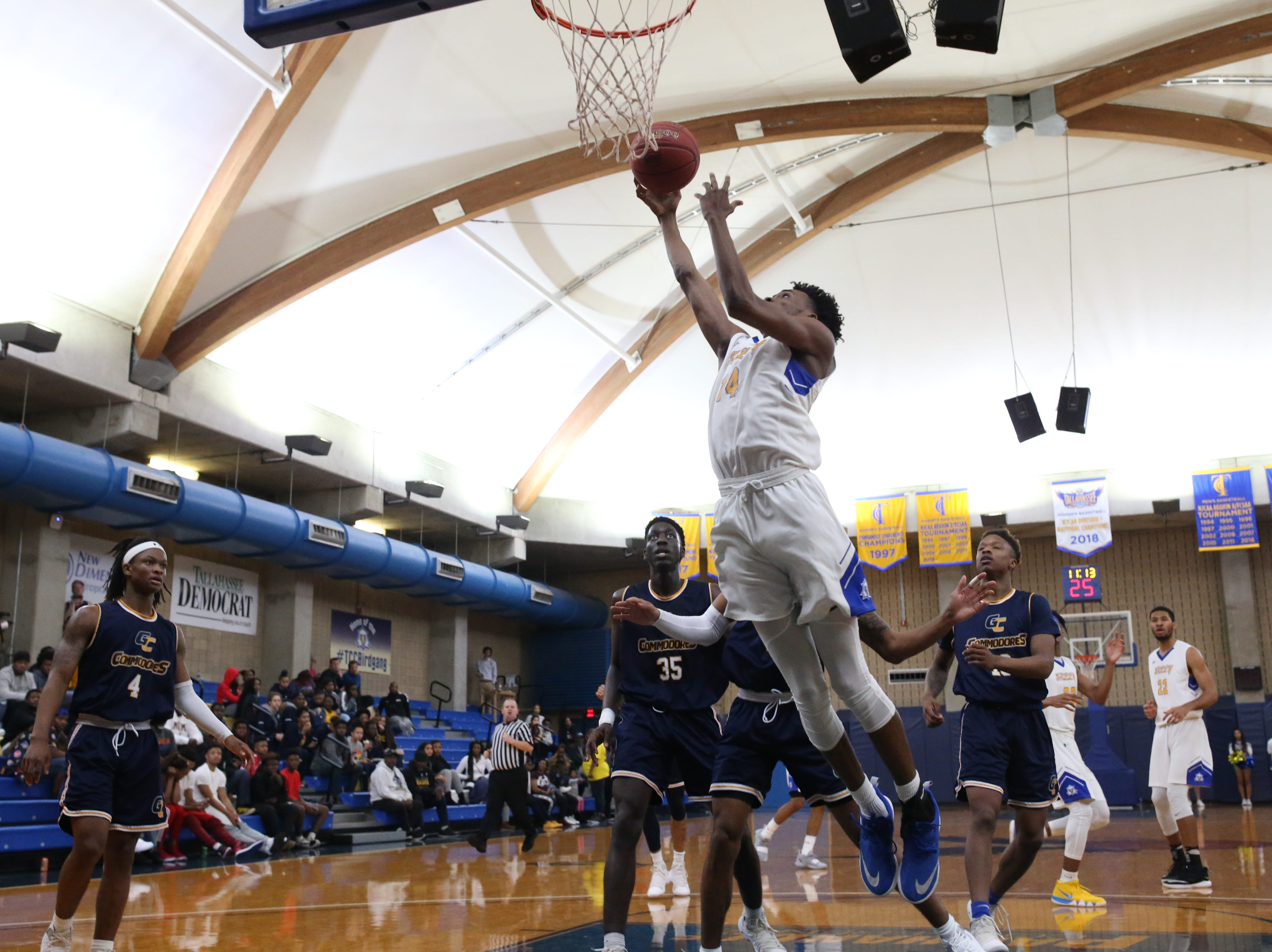 Tallahassee Community College Eagles forward Shamon Mosley (14) goes in for a layup. The Tallahassee Community College Eagles host the Gulf Coast State College Commodores in a conference match-up in the Eagledome, Saturday, Jan. 5, 2019.
