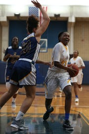 Tallahassee Community College Eagles guard Juliunn Redmond (23) drives the ball in for a layup versus Gulf Coast State College Commodores on Saturday, Jan. 5, 2019.