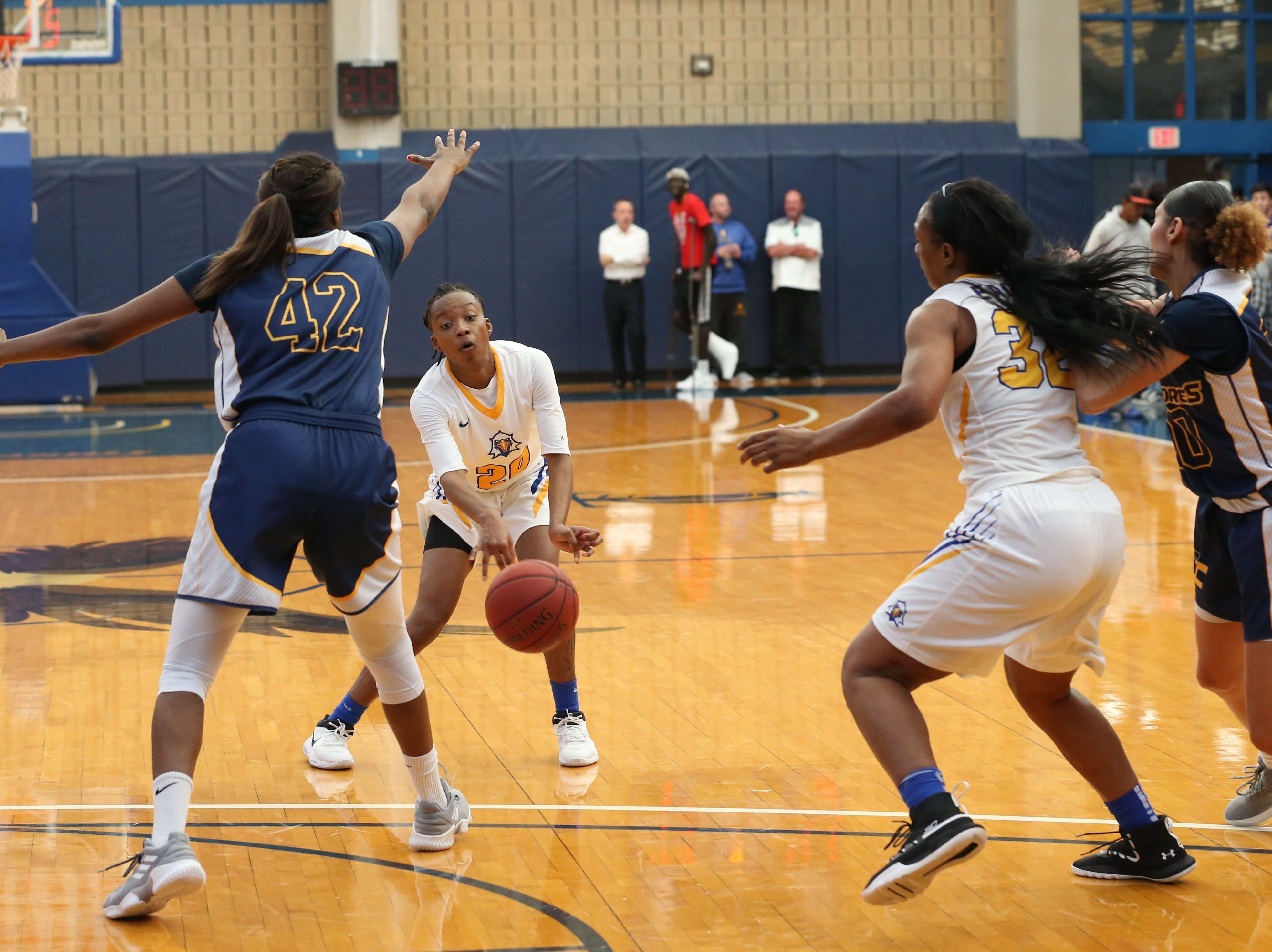 Tallahassee Community College Eagles guard Daisha Bradford (20) passes to Tallahassee Community College Eagles forward Jamyra McChristine (32). The Tallahassee Community College Eagles host the Gulf Coast State College Commodores in a conference match-up in the Eagledome, Saturday, Jan. 5, 2019.