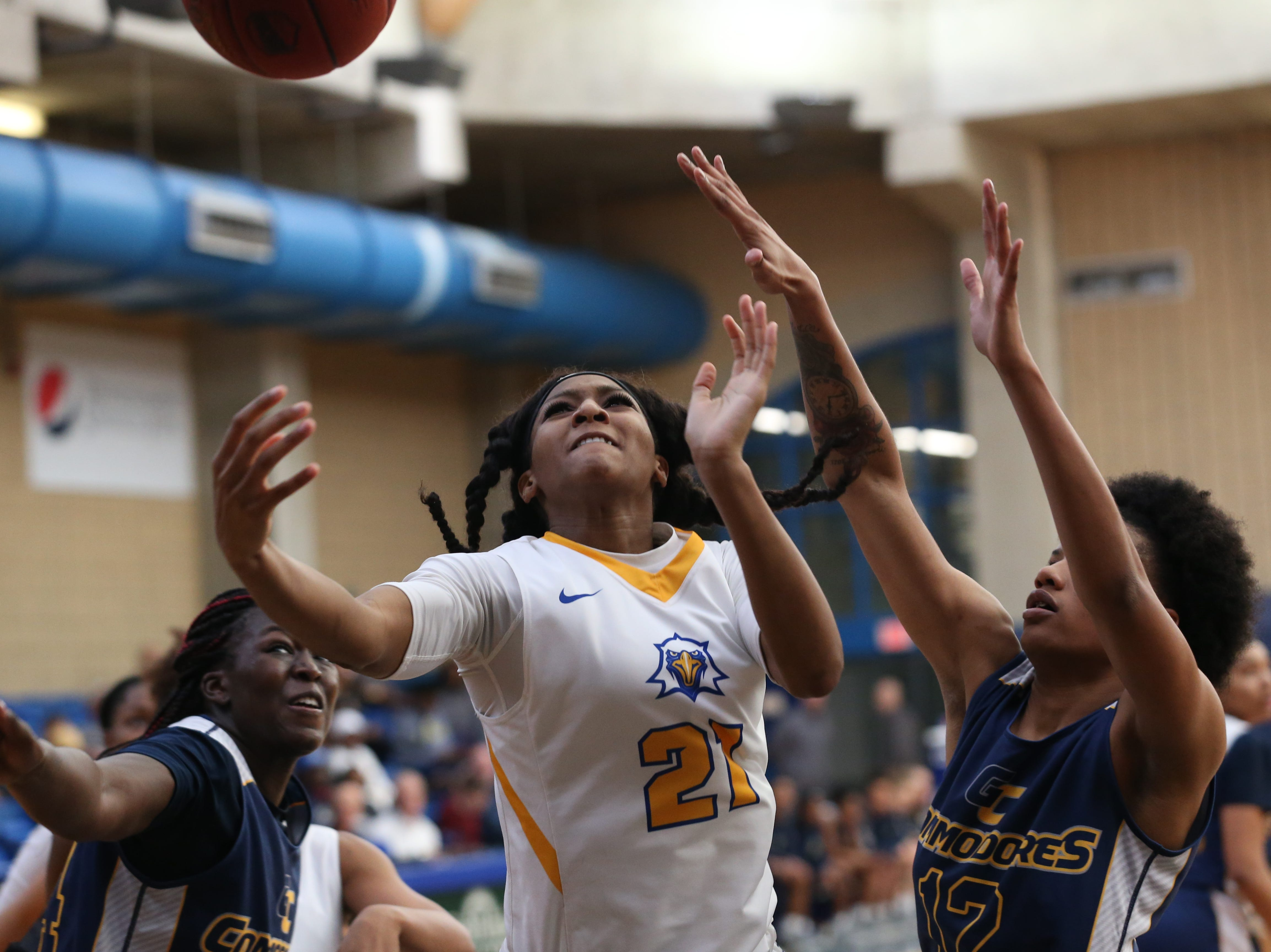 Tallahassee Community College Eagles forward Jada Perry (21) goes to the hoop for a layup. The Tallahassee Community College Eagles host the Gulf Coast State College Commodores in a conference match-up in the Eagledome, Saturday, Jan. 5, 2019.