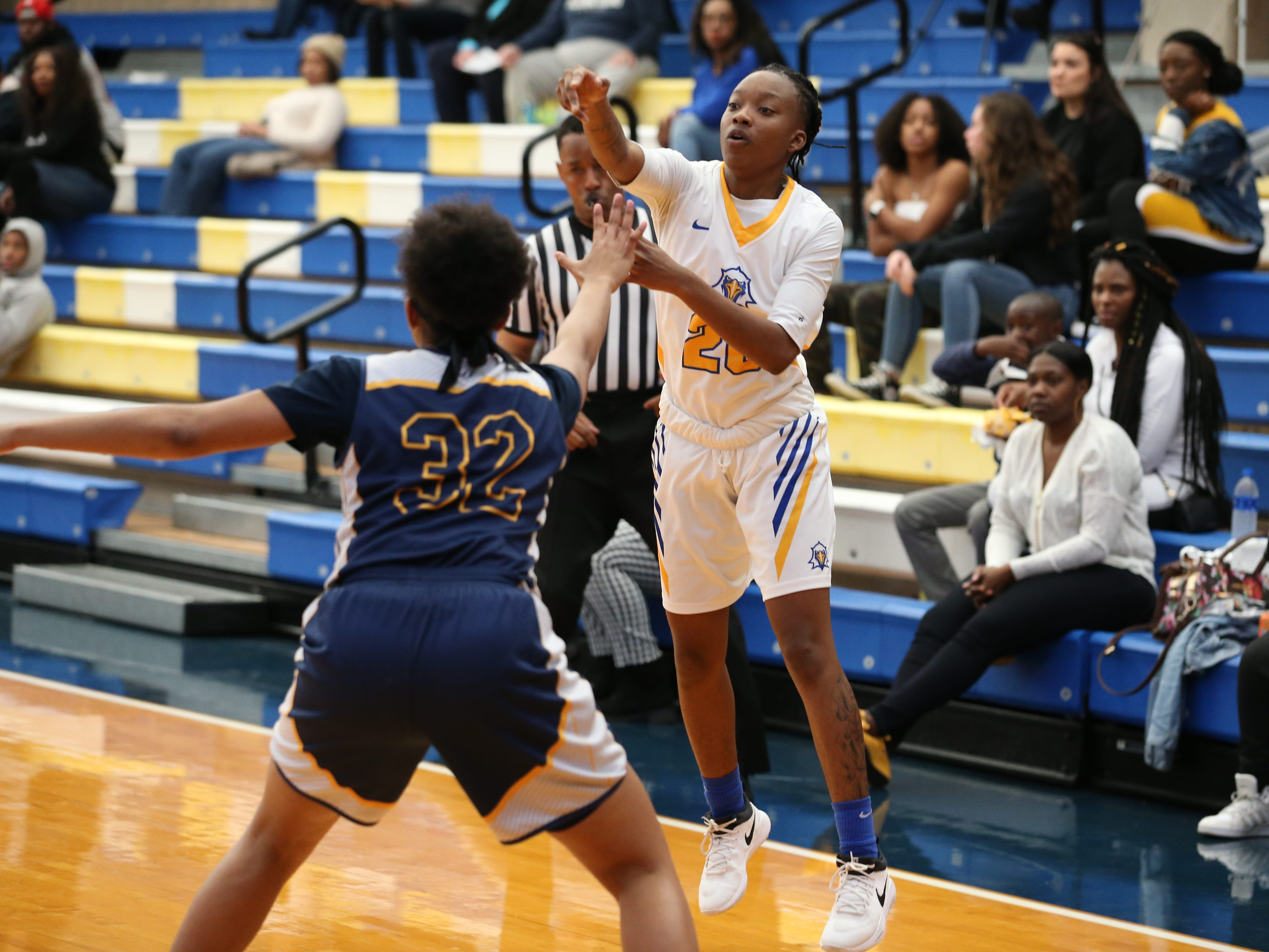 Tallahassee Community College Eagles guard Juliunn Redmond (23) passes over her defender to a teammate. The Tallahassee Community College Eagles host the Gulf Coast State College Commodores in a conference match-up in the Eagledome, Saturday, Jan. 5, 2019.