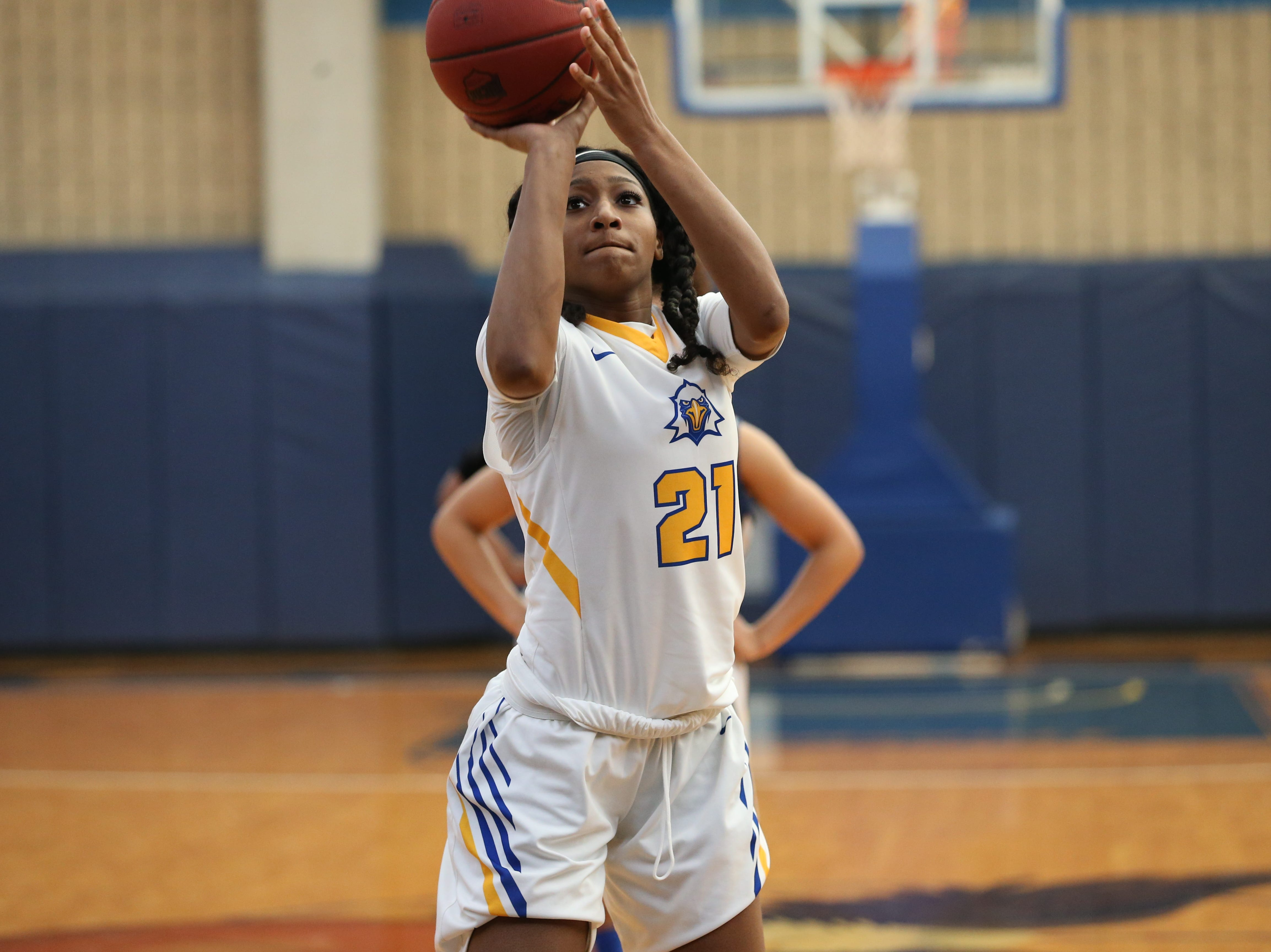 Tallahassee Community College Eagles forward Jada Perry (21) shoots a free throw. The Tallahassee Community College Eagles host the Gulf Coast State College Commodores in a conference match-up in the Eagledome, Saturday, Jan. 5, 2019.