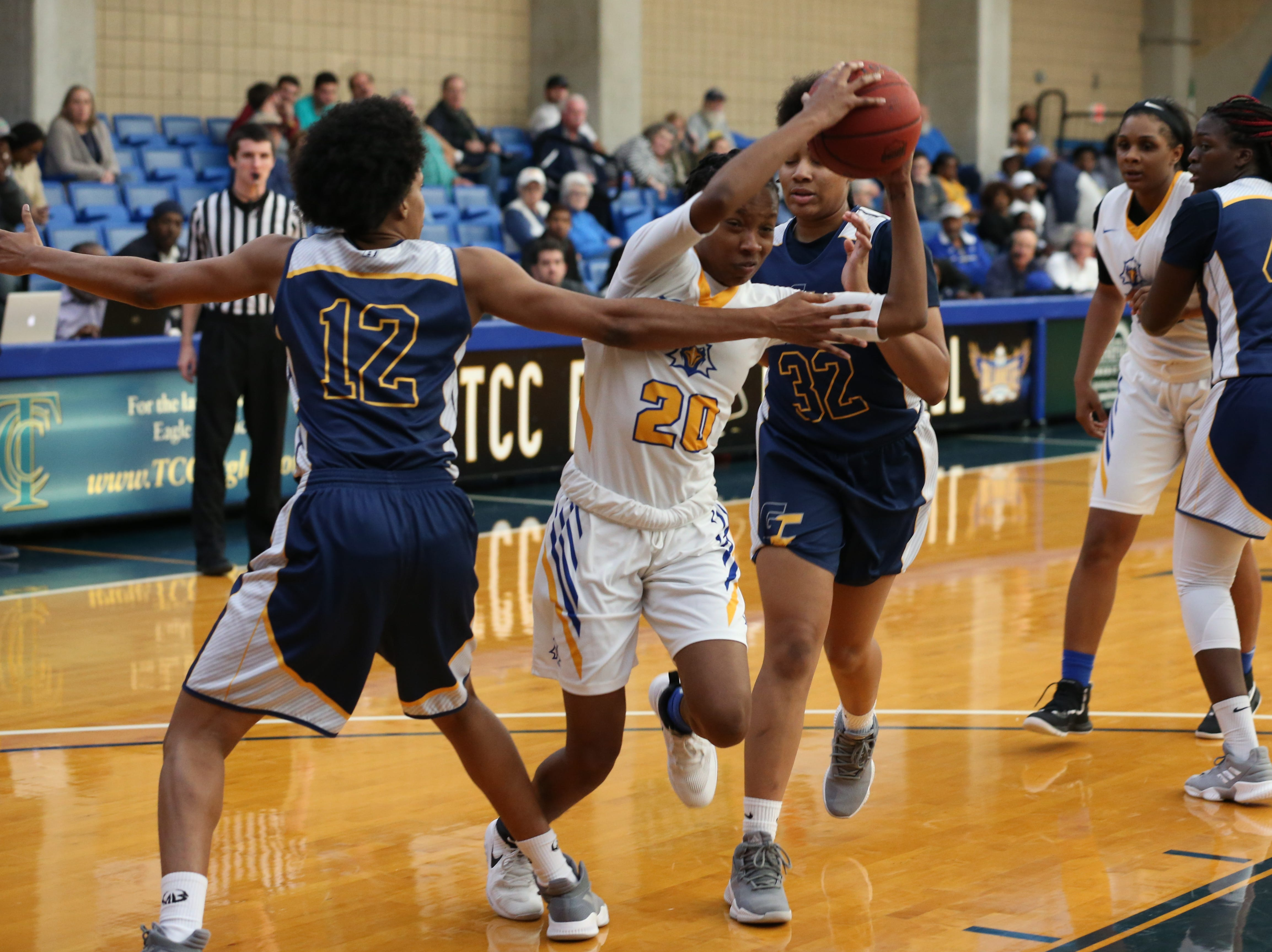 Tallahassee Community College Eagles guard Daisha Bradford (20) fights her way through her defenders towards the basket. The Tallahassee Community College Eagles host the Gulf Coast State College Commodores in a conference match-up in the Eagledome, Saturday, Jan. 5, 2019.