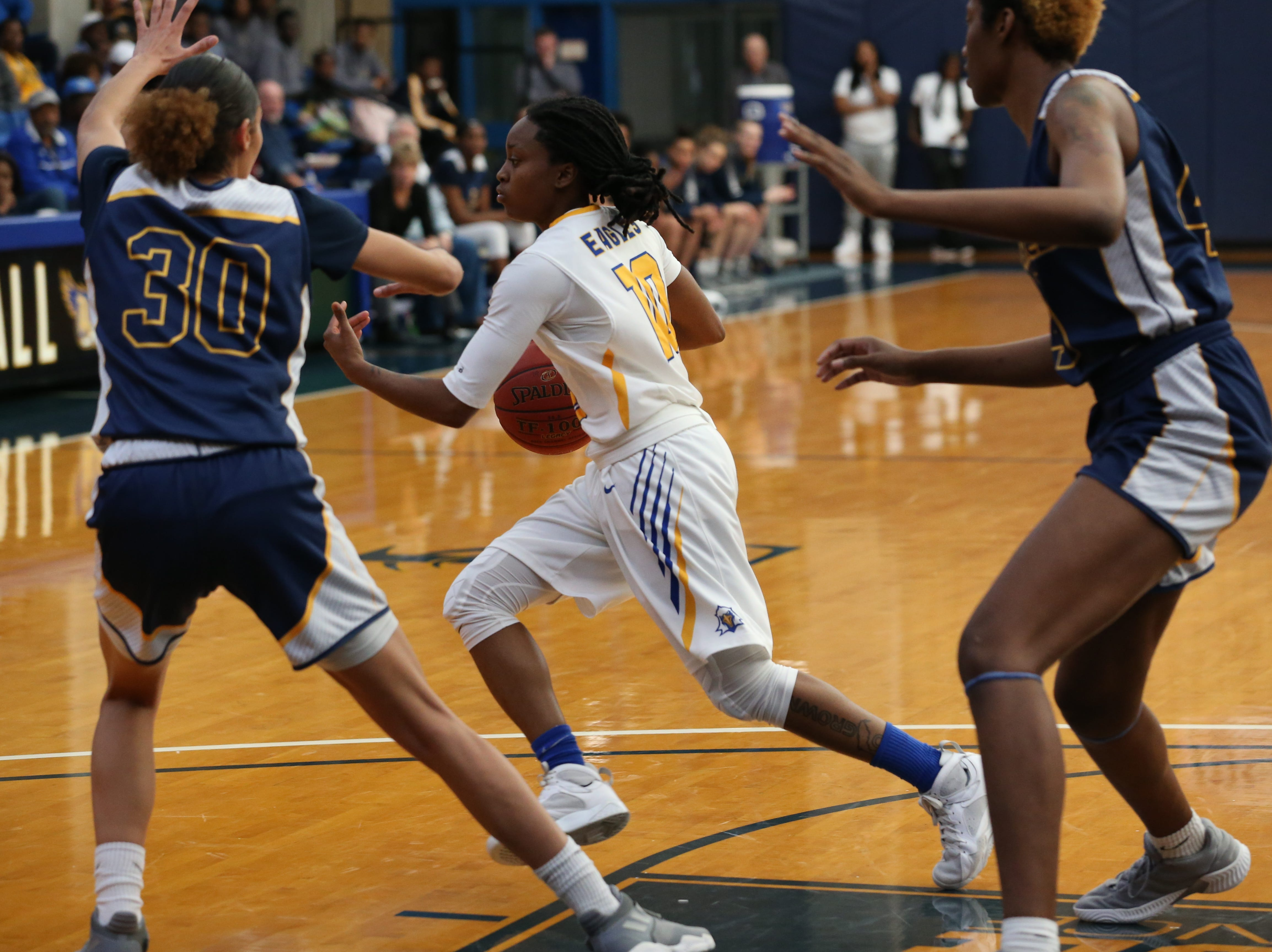 Tallahassee Community College Eagles guard Tameria Johnson (10) tries to make her way around her defender. The Tallahassee Community College Eagles host the Gulf Coast State College Commodores in a conference match-up in the Eagledome, Saturday, Jan. 5, 2019.