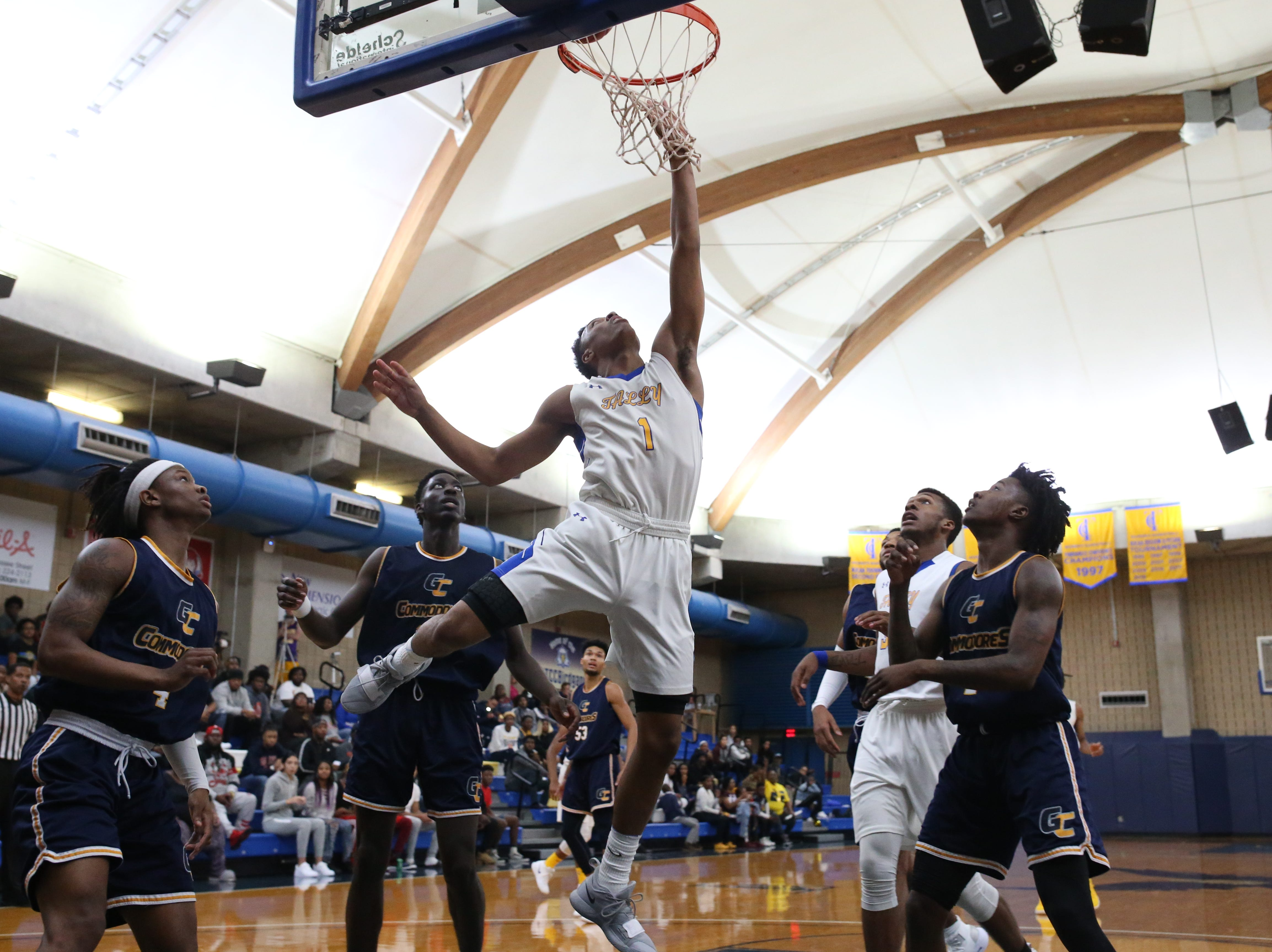 Tallahassee Community College Eagles guard Eric Boone (1) reaches for the rebound. The Tallahassee Community College Eagles host the Gulf Coast State College Commodores in a conference match-up in the Eagledome, Saturday, Jan. 5, 2019.