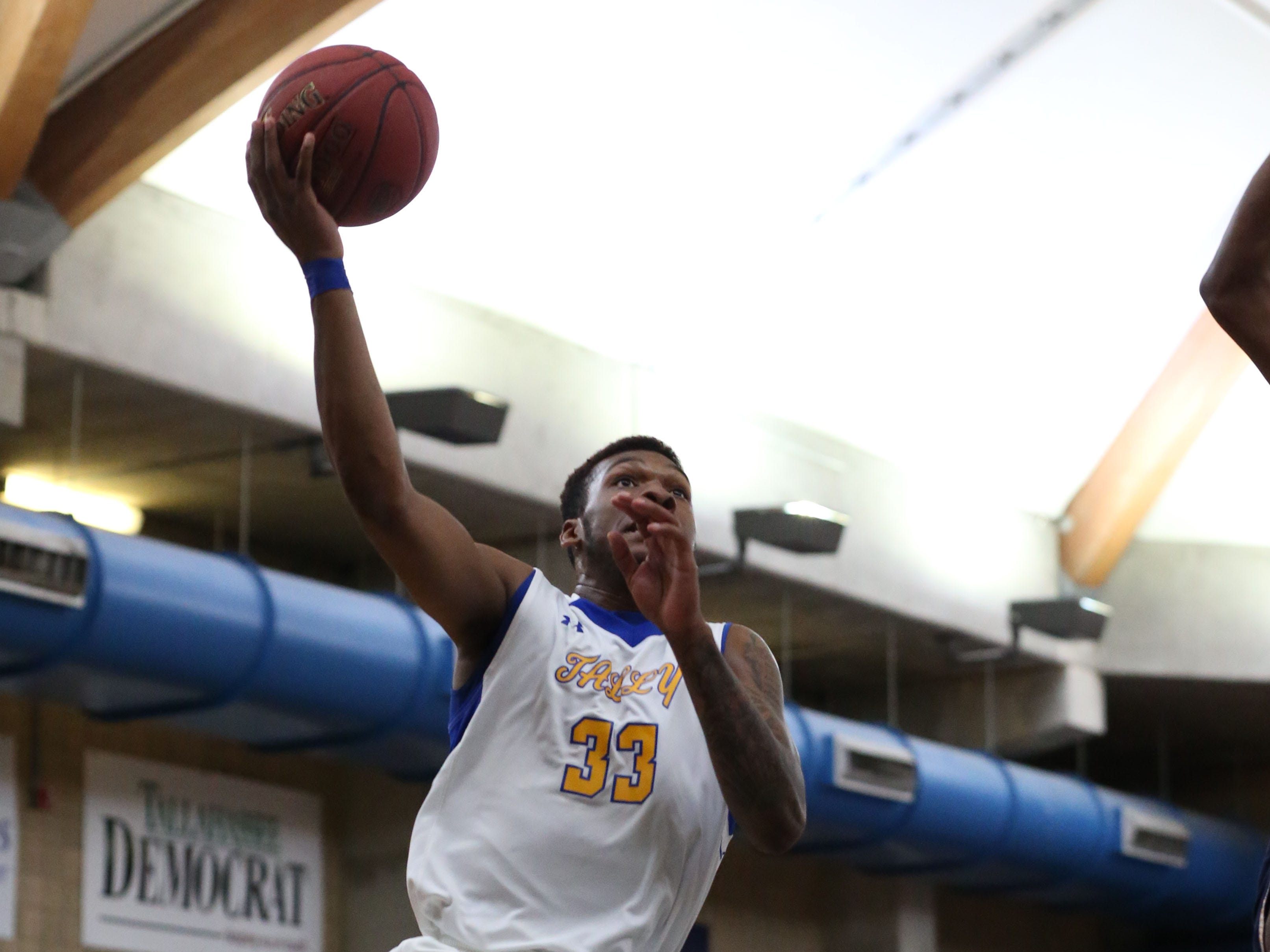 Tallahassee Community College Eagles forward Natorian Tyson (33) goes in for a layup. The Tallahassee Community College Eagles host the Gulf Coast State College Commodores in a conference match-up in the Eagledome, Saturday, Jan. 5, 2019.