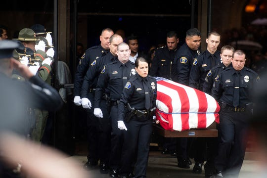 """Newman police officers carry the body of their slain colleague Cpl. Ronil """"Ron"""" Singh during his funeral in Modesto, California."""