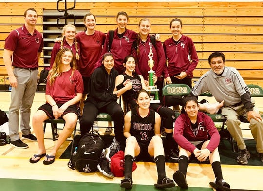 The Foothill Tech girls basketball team poses with the first-place trophy after winning the Santa Barbara Tournament of Champions.