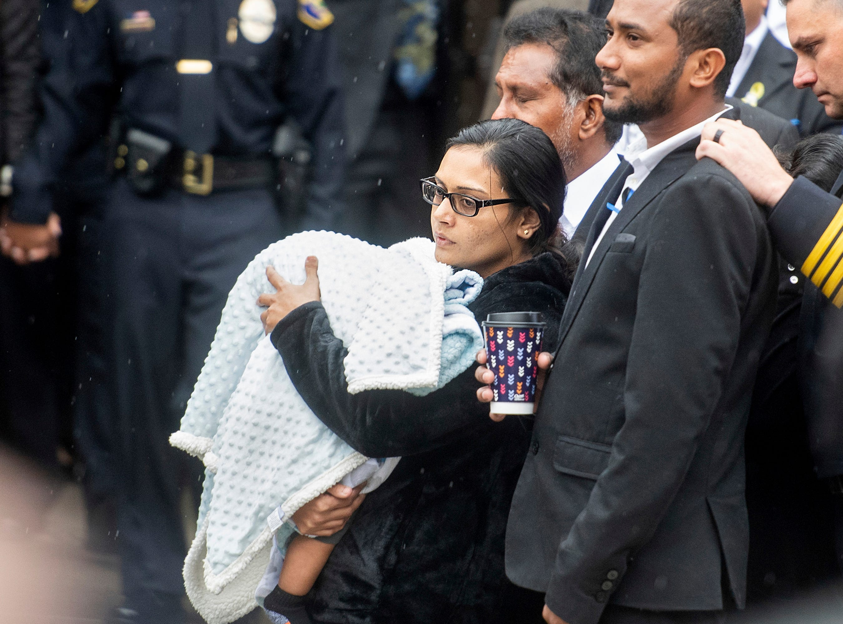"Anamika Singh, widow of slain Newman Police Cpl. Ronil ""Ron"" Singh, holds their 5-month-old child during her husband's funeral on Saturday in Modesto."