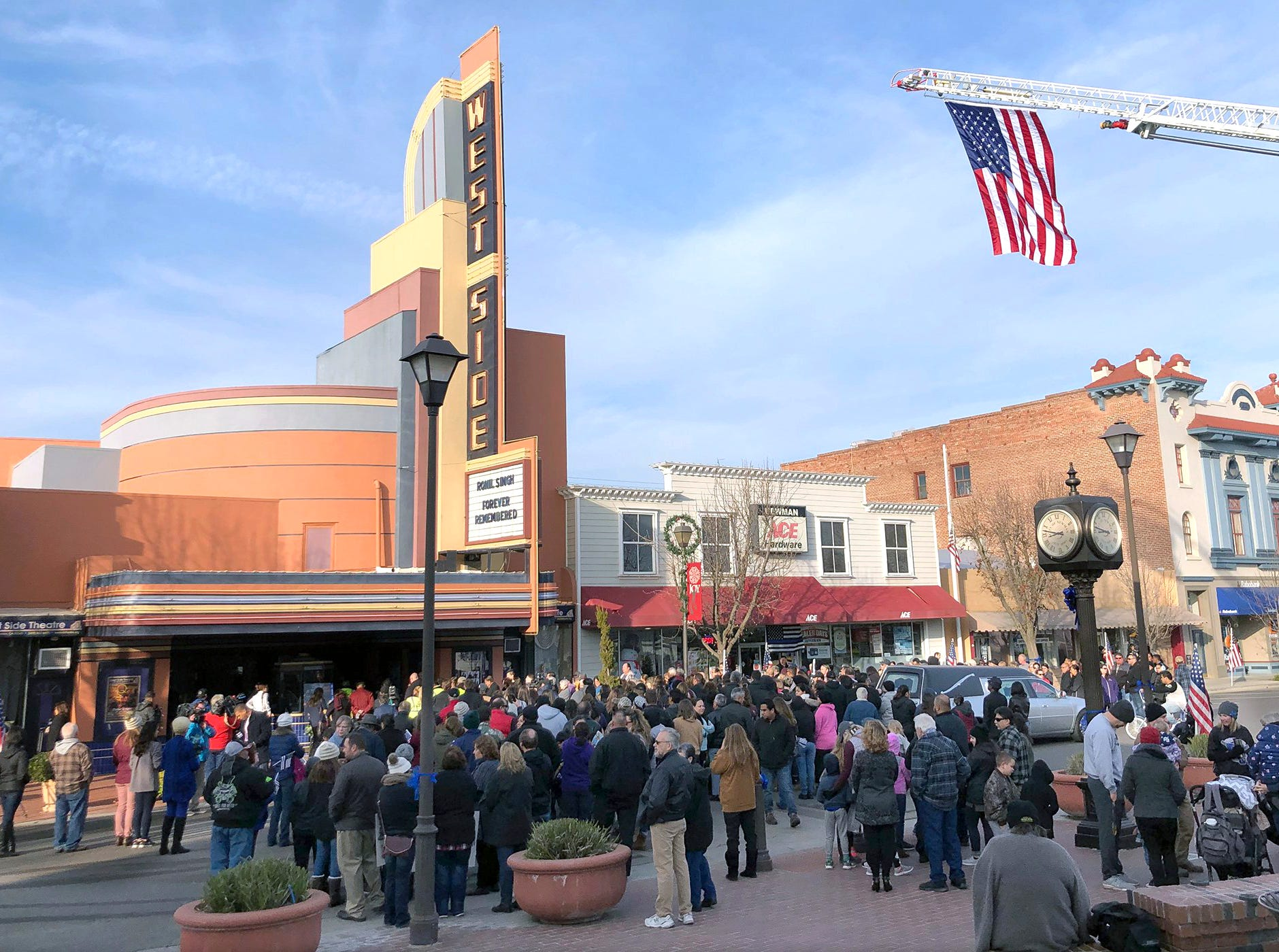 People gather outside the West Side Theatre for the public viewing of Newman Police Cpl. Ronil Singh on  Friday in Newman.