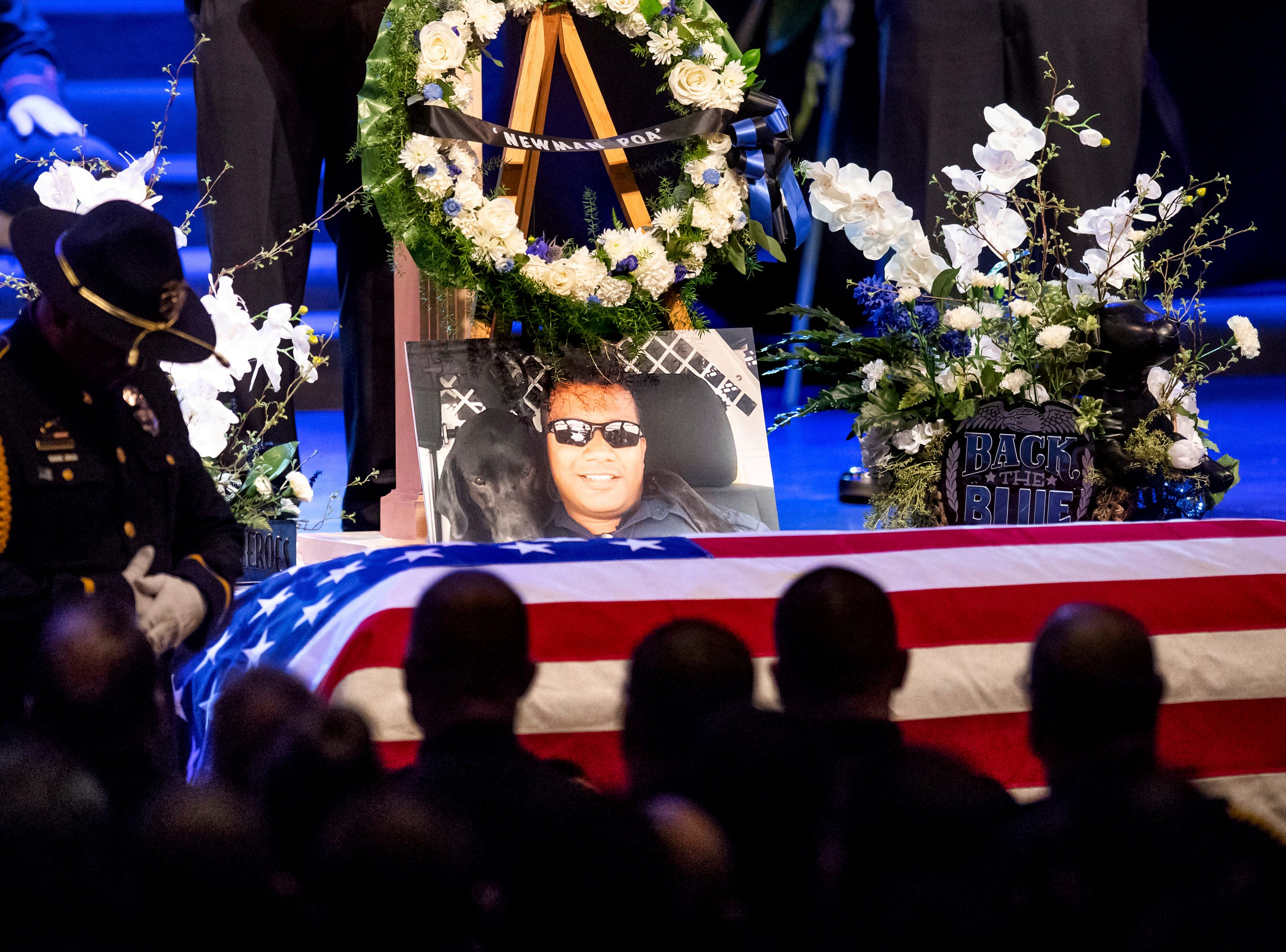 "A picture of slain Newman Police Cpl. Ronil ""Ron"" Singh rests atop the casket during his funeral on Saturday in Modesto."