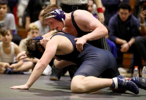 Jake Logan of New Rochelle defeated Alex Behar of Byram Hills for the 182 pound championship at the Murphy Guccione Shoreline Wrestling Tournament at New Rochelle High School Jan. 5, 2018.