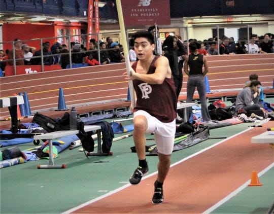 Yonkers resident Tom Miguel Negrete of Fordham Prep takes off down pole vault runway during 2019 Hispanic Games pole vault. He finished third.