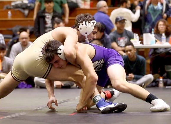 AJ Kovacs of Iona Prep defeated Joey McGinty of Monroe for the 145 pound championship at the Murphy Guccione Shoreline Wrestling Tournament at New Rochelle High School Jan. 5, 2018.