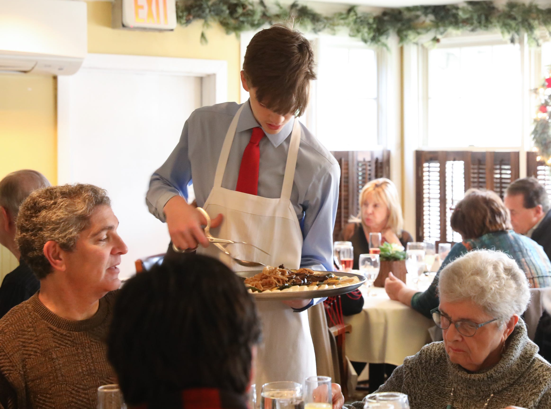 A server serves Grilled Vegetables table side during Sunday brunch at Restaurant X in Congers on Sunday, January 6, 2019.