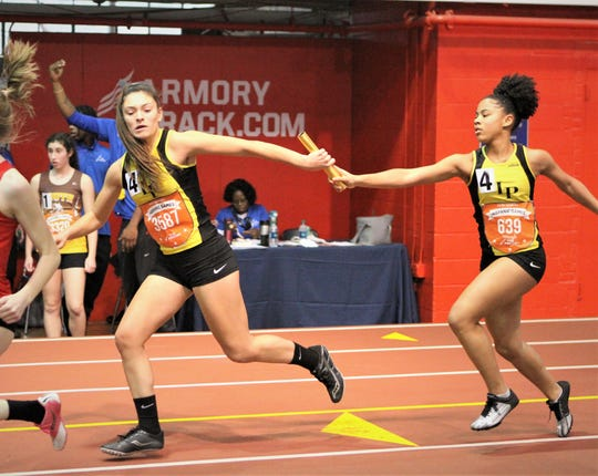 Lauren Salazar takes baton from Lakeland/Panas teammate Makayla Waugh (r) during 2019 Hispanic Games girls 4x200 relay.