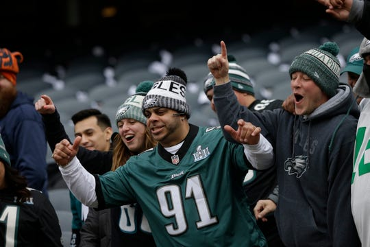 Philadelphia Eagles fans react before an NFL wild-card playoff football game between the Eagles and Chicago Bears Sunday, Jan. 6, 2019, in Chicago. (AP Photo/David Banks)