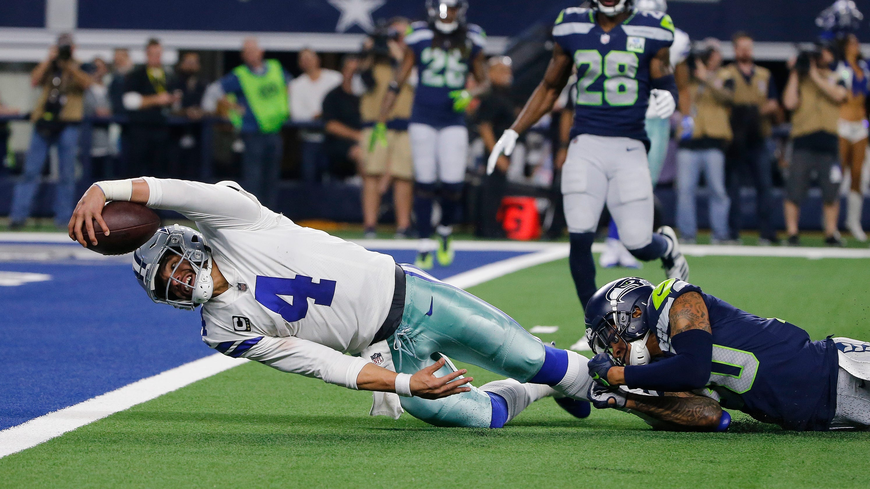83e21bd0206 Dak Prescott runs Seattle right out of the playoffs with clutch fourth  quarter