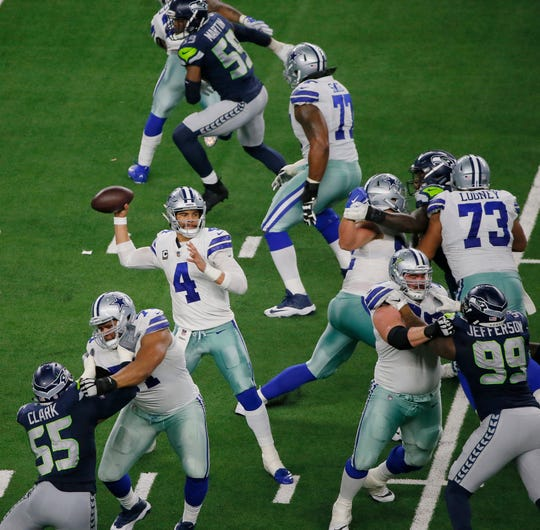 Dallas Cowboys quarterback Dak Prescott (4) works from the pocket against the Seattle Seahawks during the second half of the NFC wild-card NFL football game in Arlington, Texas, Saturday, Jan. 5, 2019. The Cowboys won 24-22. Prescott passed for 226 yards and rushed for 29 yards with two total TDs.