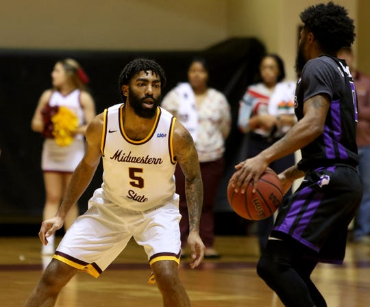 Midwestern State's Josh Wallace guards Tarleton's Corinthian Ramsey Saturday, Jan. 5, 2019, at D.L. Ligon Coliseum.